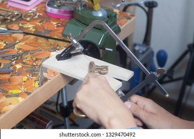 Jeweler working with jewerly saw.