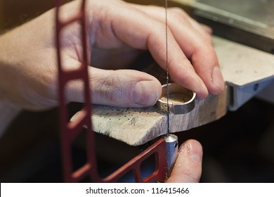Jeweler is working with an unfinished ring