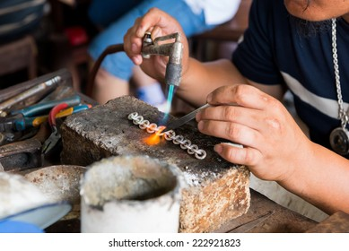 jeweler's hands while working making jewelry in Vientiane, Laos.