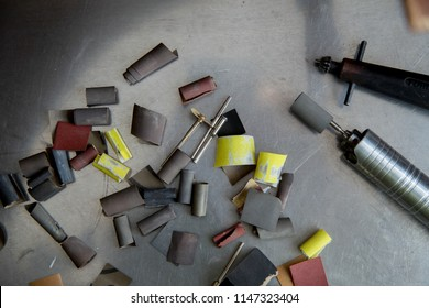 Jeweller's tools - pliers, cutters, carving knives, moulds, raw silver  pieces, engraver, sander, jeweler's bench pin