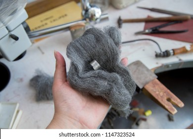 Jeweller's tools - steel wool, pliers, cutters, carving knives, moulds, raw silver  pieces, engraver, sander, jeweler's bench pin