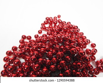 Jewellery background with red perls. Perl for Valentines day for people in love