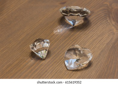 Jewellery made of glass on a wooden background