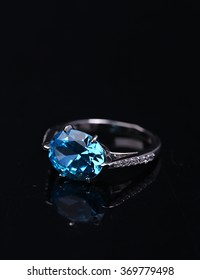 Jewellery ring on a black background