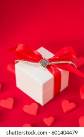Jewellery silver charm bracelet on the gift box. Small heart. Best gift for Valentines Day and Mothers day. 8 march. Engagement and wedding. Gift favorite.