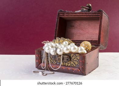 Jewelry Concept - Concept or Metaphor for selling old pearls and gold jewelry for cash