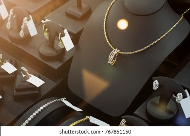 jewelry diamond gold shop with rings and necklaces luxury retail store window display showcase