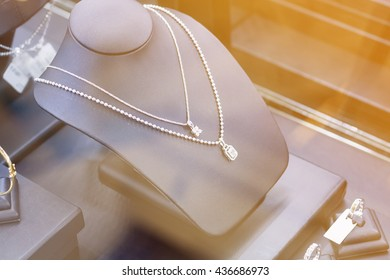 Jewelry diamond necklace in jewelry shop store window display showcase