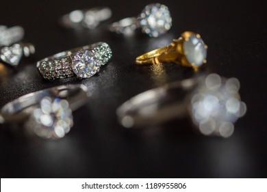 Jewelry diamond rings set on black background close up