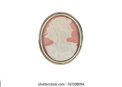 Jewelry fashion gold cameo brooch  with woman profile isolated on white