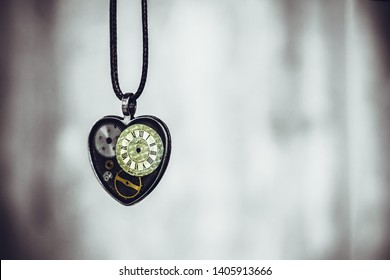 jewelry in the form of a heart, and inside it a dial from the watch; may mean that there is always time for love, it's never too late to love, etc.