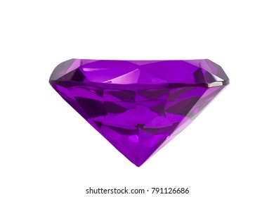 Jewelry and gemstones concept with close up on a purple tanzanite gemstone isolated on a white background with clipping path