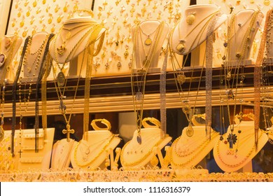 Jewelry gold necklaces rings bracelets watch wealth, Jewelry diamond rings and necklaces show in luxury retail store window display showcase background.