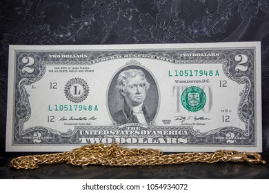 Jewelry golden and money on the black background. banknote dollar. concept of pawnshop.