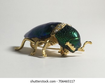 Jewelry Green Scarab Beetle Insect Brass Pin Wood Boring Bug. Made From Natural Metallic Wood-Boring Beetle. Man-Made Rhinestones included.Mix with Gold Plated Brass White background
