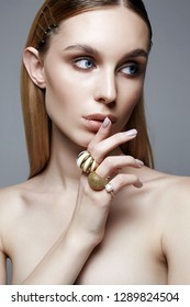 jewelry on beautiful girl with blue eyes. Blonde woman with make-up and jewels rings. Beauty Fashion Portrait