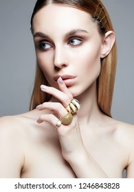 jewelry on beautiful girl. young blonde woman with make-up and jewels accessories. Beauty Fashion Portrait