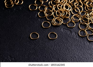 Jewelry for piercing on dark background. Stock Image macro. Top view.