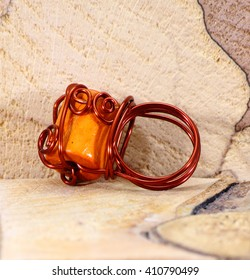 Jewelry from recycled copper wire and beads.Recycling. Open aperture, shallow depth of field. local focus