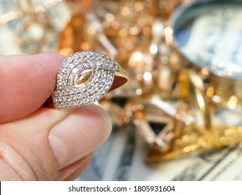 jewelry scrap of gold and silver and money, pawnshop concept, jewerly inspect and verify