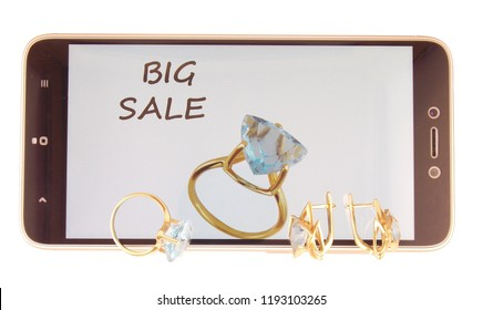 Jewelry with topazes on the smartphone screen. Sale.On a white background.