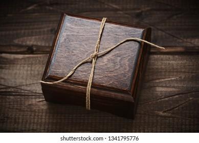 jewelry wooden box on wooden background. Gift box. Dark wooden casket
