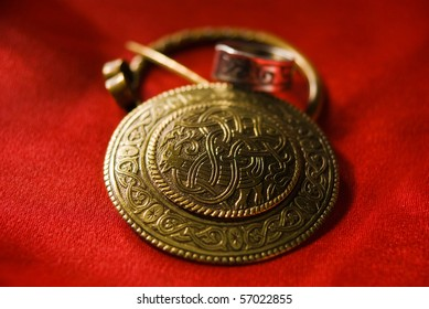 Jewels with ancient Slavic designs on a red background