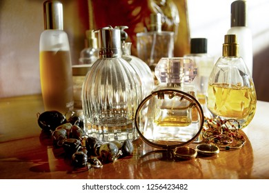 jewels and perfumes on a wooden background