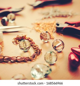 Jewels and tools on jewelers table