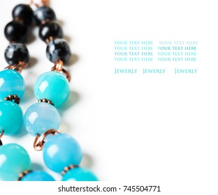 jewerly with chalcedony and obsidian around white background