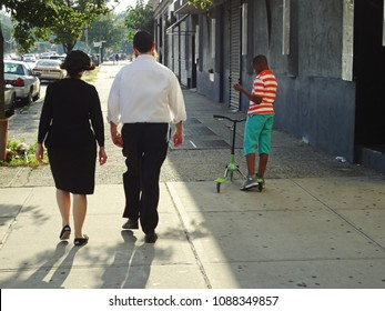 Jewish couple walking on Crown Heights in Brooklyn, New York city on August 10 2017