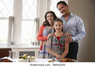 Jewish family smile to camera before Shabbat meal, close up