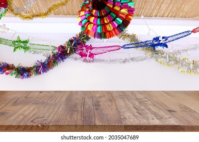 Jewish festival of Sukkot. Traditional succah (hut) with decorations. Empty wooden old table for product display and presentation.