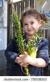 Jewish girl blessing on the four spices on Sukkot Jewish Holiday.