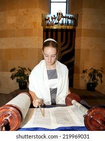 Jewish Girl Reading the Torah at her Bat Mitzvah