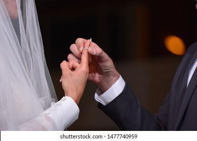 jewish groom and bride with ring at huppah