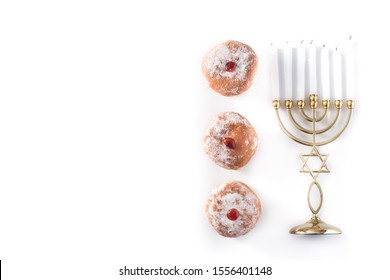 Jewish Hanukkah menorah and sufganiyot donuts isolated on white background. Copy space
