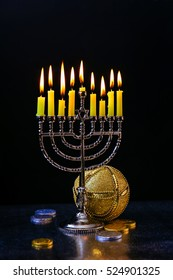 Jewish holiday Hanukkah creative background with menorah. View from above with focus on menorah.