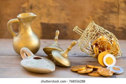 jewish holiday Hanukkah with golden dreidels and Hanukkah gelt