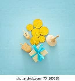 jewish holiday Hanukkah image background with traditional spinnig top and chocolate coins.