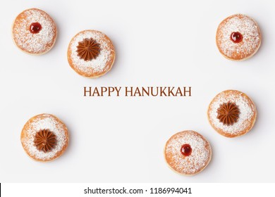 Jewish holiday Hanukkah sufganiyot on white background. View from above