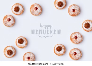 Jewish holiday Hanukkah sufganiyot on white background. Top view from above