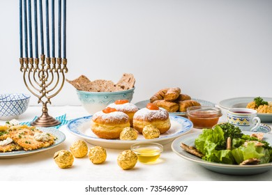 Jewish holiday Hanukkah, traditional feast side view