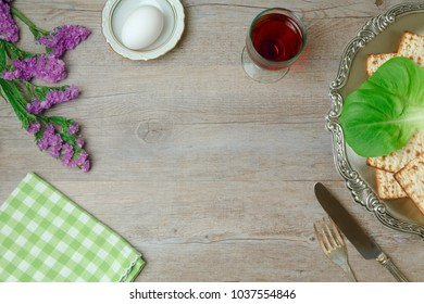Jewish holiday Passover background with wine, matzo and seder plate. Top view