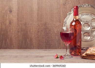 Jewish holiday Passover background with wine and seder plate on wooden table