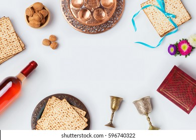 Jewish holiday Passover background with wine, matza and seder plate. View from above. Flat lay