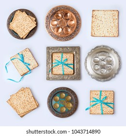Jewish holiday Passover concept with matzo and seder plate on white background. View from above. Flat lay. Hebrew Text: Passover, horseradish, celery, egg, bone, bitter herb, fruit paste