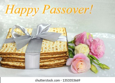 jewish holiday of Passover, gift wrap matzo, tied with a ribbon and a bouquet of peonies, inscription - Happy Passover