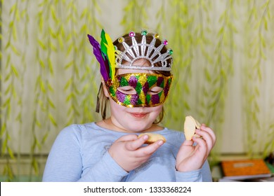 Jewish holiday Purim Beautiful Little Girl In Masks Celebrating Purim, Of Happy People In Festive Carnival Masks Stand