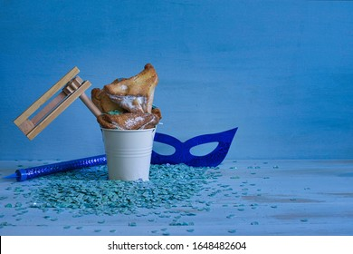 Jewish holiday Purim concept on blue background with copy space.